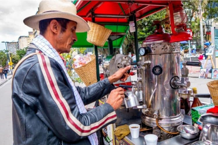 "A man pouring ""sock coffee"" in Columbia."