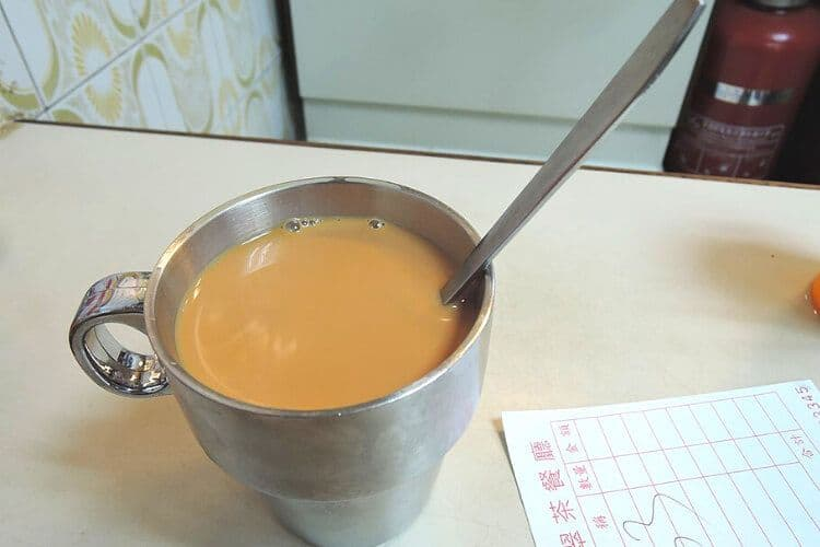 Coffee in a metal cup in Hong Kong.