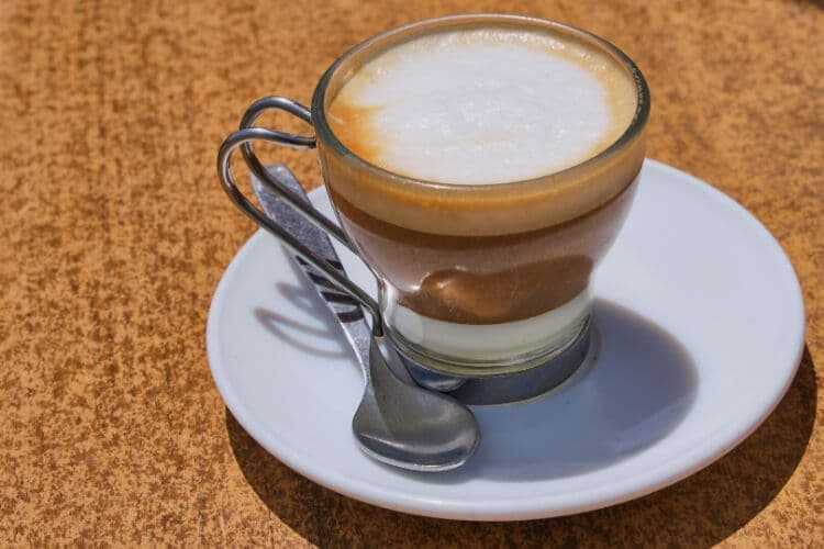A brown coffee on a white saucer in Spain.