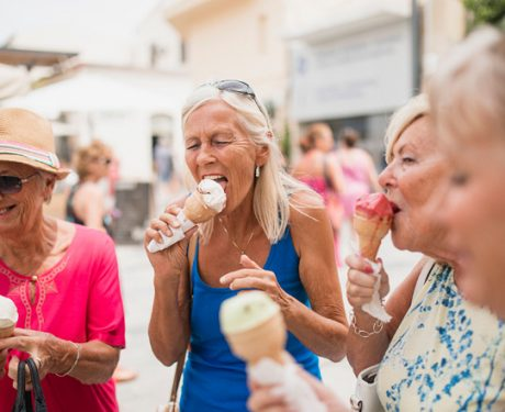 Woman eating ice cream in Europe worry-free