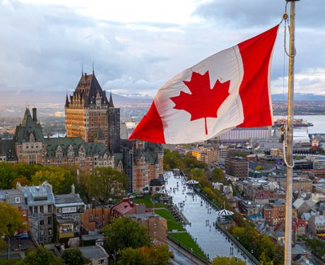 Canadian flag in front of Château Frontenac in Quebec City