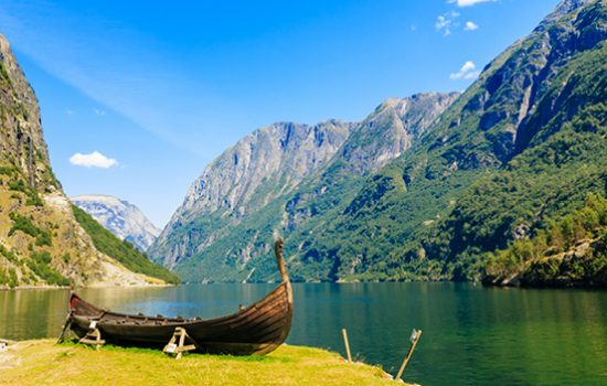Wooden boat in the fjords of Viking Valley