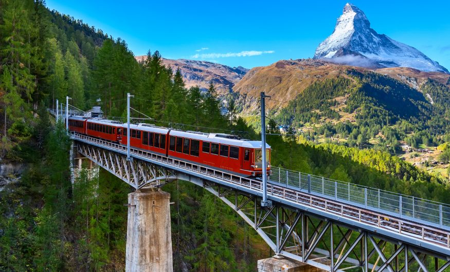 The Swiss Alpine Express travelling across a birdge during a rail