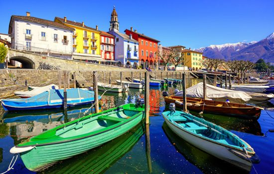 Colourful boats on the lake in Ascona, Switzerland