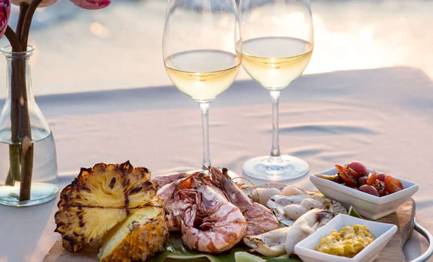 Wine and seafood on a table by the sea